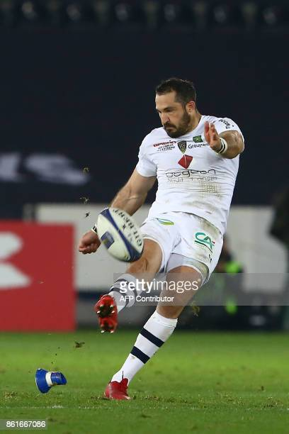 Clermont's South African fullback Scott Spedding converts a penalty from beyond the halfway line during the European Rugby Champions Cup rugby union...