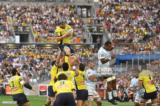 Clermont's South African lock Phillip Van Der Merwe catches the ball in a lineout during the French Top 14 rugby union match between Racing 92 and...