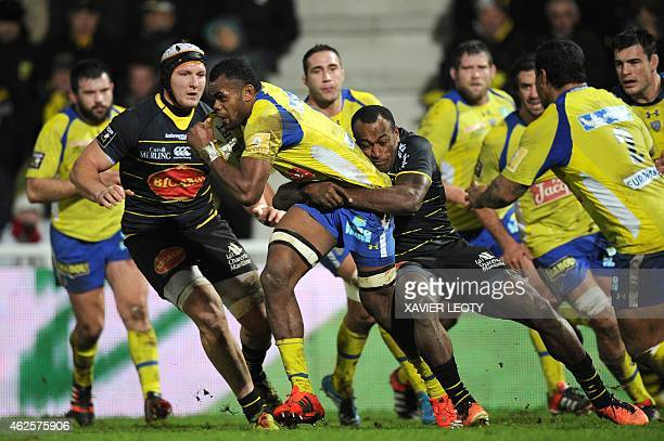 Clermont's wing Fijian Napolioni Nalaga vies with La Rochelle's wing Fidjian Sireli Bobo during the French Top 14 rugby union match between La...