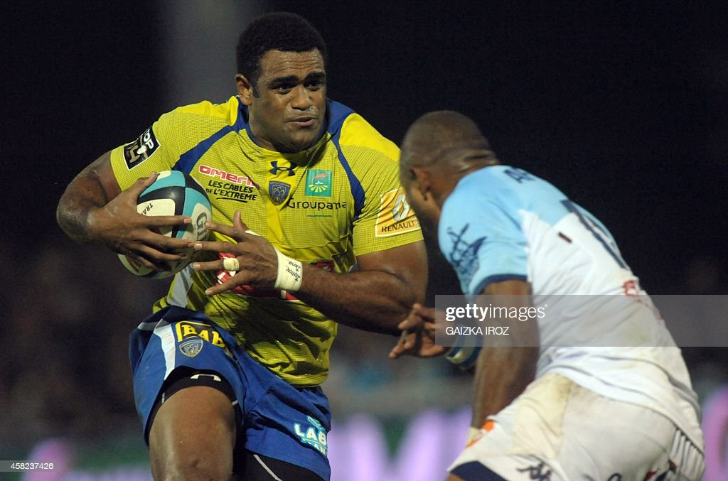 Clermont's winger Naipolioni Nalaga runs with th ball during the French Top 14 rugby union match between Aviron Bayonnais and ASM ClermontFerrand at...