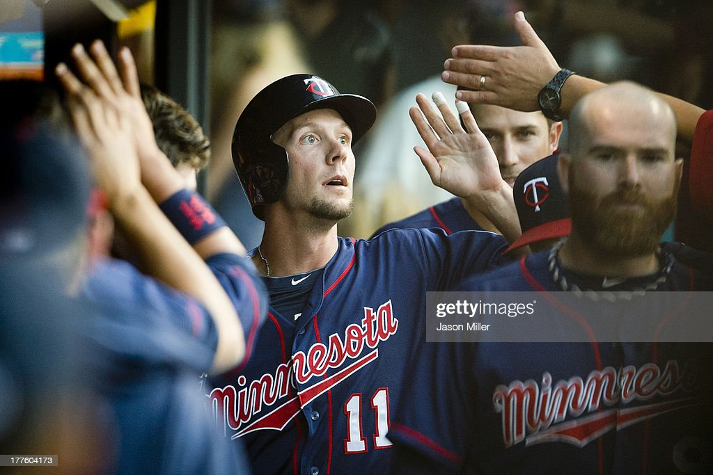 <a gi-track='captionPersonalityLinkClicked' href=/galleries/search?phrase=Clete+Thomas&family=editorial&specificpeople=4952485 ng-click='$event.stopPropagation()'>Clete Thomas</a> #11 of the Minnesota Twins celebrates after scoring on a sacrifice fly by Brian Dozier #2 during the third inning against the Cleveland Indians at Progressive Field on August 24, 2013 in Cleveland, Ohio.