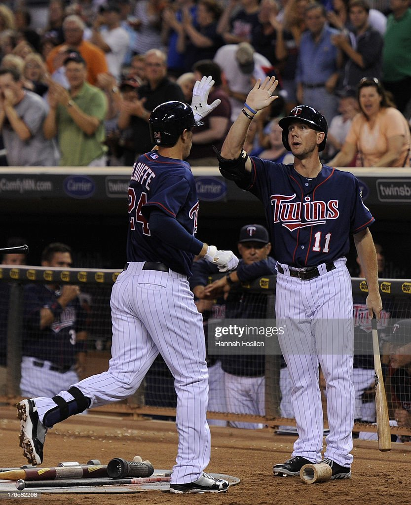 <a gi-track='captionPersonalityLinkClicked' href=/galleries/search?phrase=Clete+Thomas&family=editorial&specificpeople=4952485 ng-click='$event.stopPropagation()'>Clete Thomas</a> #11 of the Minnesota Twins congratulates teammate <a gi-track='captionPersonalityLinkClicked' href=/galleries/search?phrase=Trevor+Plouffe&family=editorial&specificpeople=5722348 ng-click='$event.stopPropagation()'>Trevor Plouffe</a> #24 on hitting a solo home run against the Chicago White Sox during the fifth inning of the game on August 15, 2013 at Target Field in Minneapolis, Minnesota.