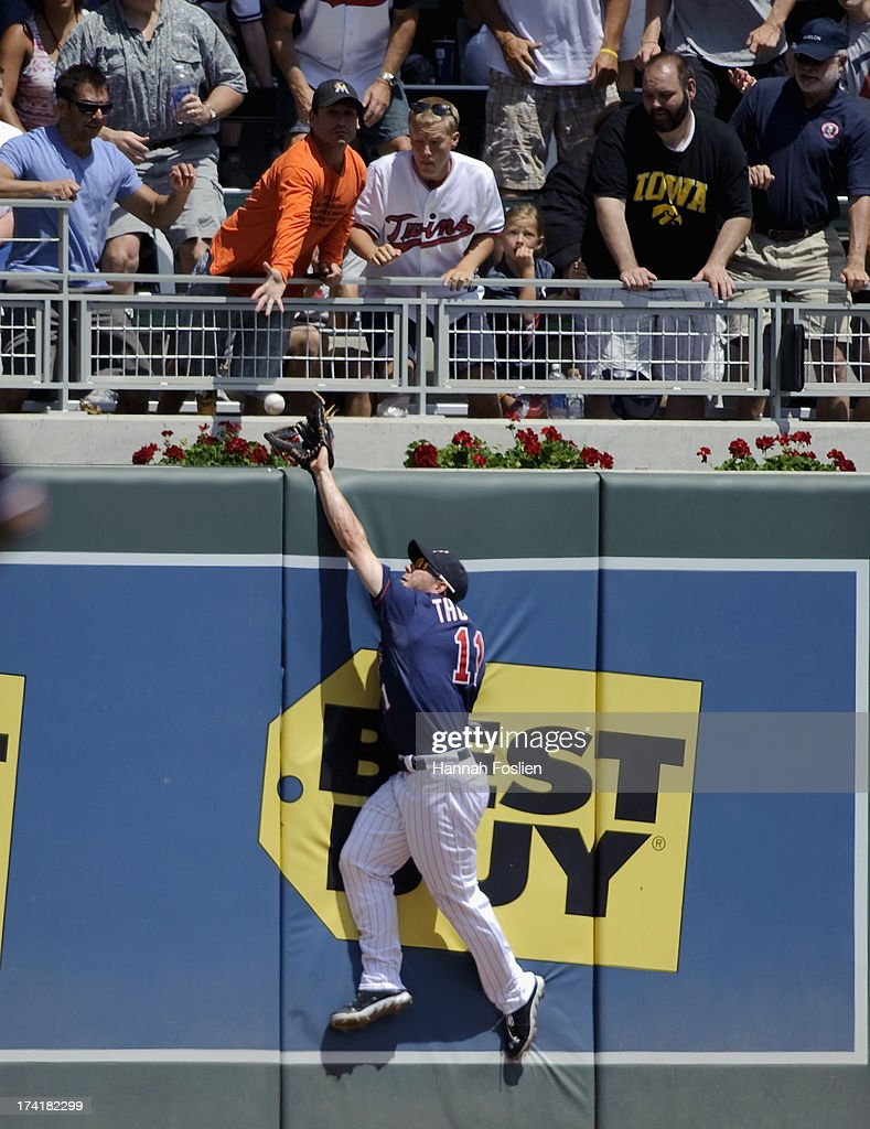 Clete Thomas #11 of the Minnesota Twins misses a catch of the two run home run ball hit by Jason Kipnis #22 of the Cleveland Indians during the third inning of the game on July 21, 2013 at Target Field in Minneapolis, Minnesota.