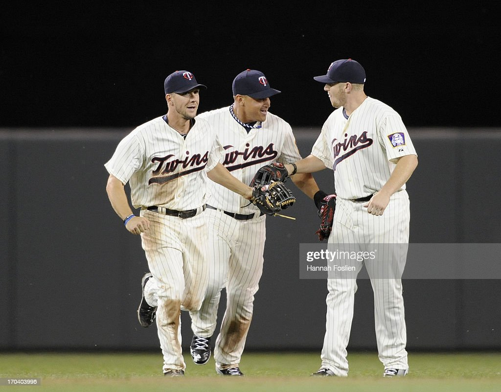 Clete Thomas #11, Oswaldo Arcia #31 and Chris Parmelee #27 of the Minnesota Twins celebrate a win of the game against the Philadelphia Phillies on June 12, 2013 at Target Field in Minneapolis, Minnesota. The Twins defeated the Phillies 4-3.