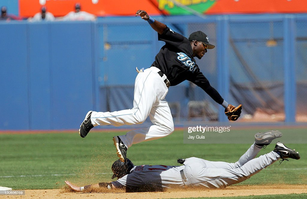 Clevelan 3rd baseman Aaron Boone slides safely into 2nd base with a stolen base avoiding the tag of Toronto's Orlando Hudson in the 4-1 win over the Blue Jays at Rogers Centre, Toronto, Aug. 28, 2005.
