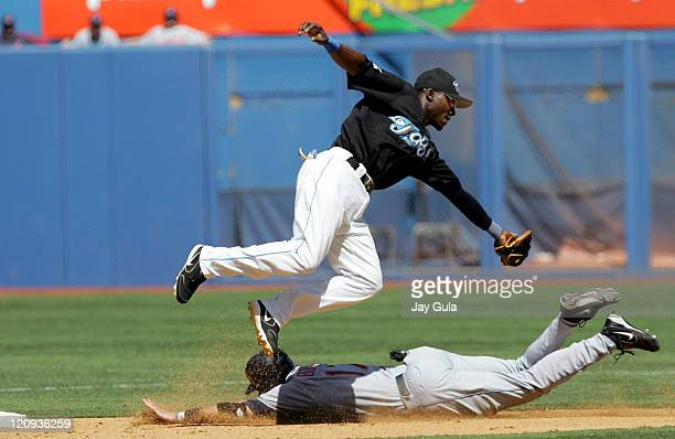 Clevelan 3rd baseman Aaron Boone slides safely into 2nd base with a stolen base avoiding the tag of Toronto's Orlando Hudson in the 41 win over the...