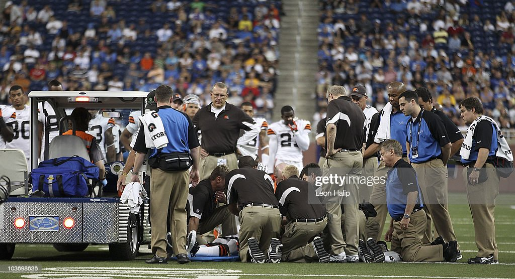 Cleveland Brown medical staff checks on Nick Sorensen #27 of the Cleveland Browns after an injury during the second quarter of a preseason game against the Detroit Lions at Ford Field on August 28, 2010 in Detroit, Michigan.