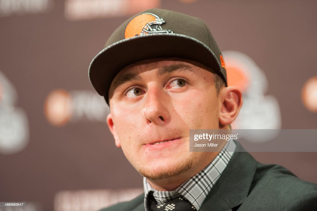 Cleveland Browns draft pick <a gi-track='captionPersonalityLinkClicked' href=/galleries/search?phrase=Johnny+Manziel&family=editorial&specificpeople=9703372 ng-click='$event.stopPropagation()'>Johnny Manziel</a> answers questions during a press conference at the Browns training facility on May 9, 2014 in Cleveland, Ohio. Manziel was selected in the first round with the 22nd pick.