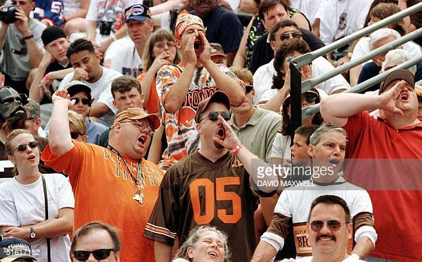 Cleveland Browns fans in the crowd during the introduction of enshrinee and former Cleveland Brown player Ozzie Newsome boo at the mention of former...
