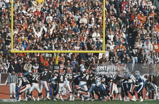 Cleveland Browns fans in the Dog Pound cheer on Phil Dawson Kicker for the Cleveland Browns as he makes a field goal attempt during the American...