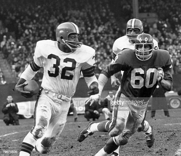 Cleveland Browns Hall of Fame running back Jim Brown races past New York Giants linebacker Jim Carroll during a 3421 Browns victory on November 14 at...