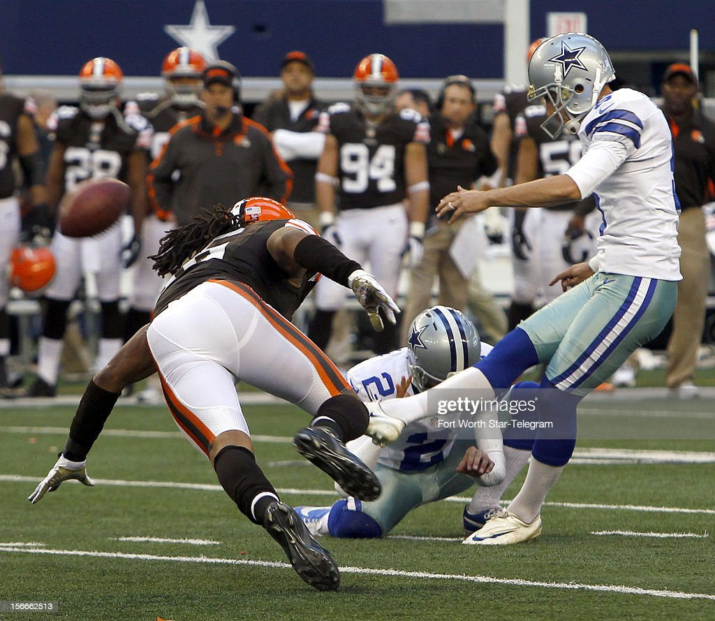 Cleveland Browns' Josh Cribbs (16) tries to stop a field goal by Dallas Cowboys kicker Dan Bailey (5) at Cowboys Stadium Sunday, November 18, 2012, in Arlington, Texas.