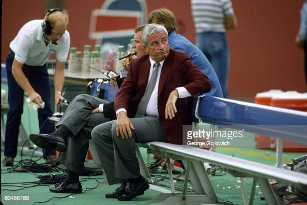 Cleveland Browns owner Art Modell looks on from the sideline while sitting next to his son David Modell before a preseason game against the Buffalo...