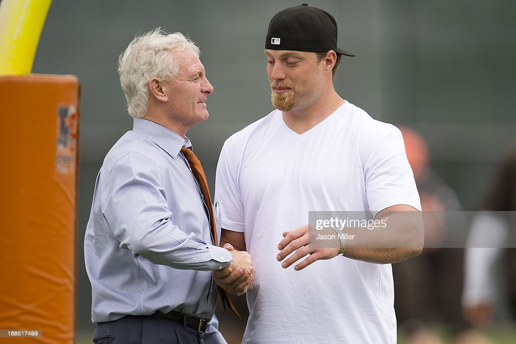 Cleveland Browns owner Jimmy Haslam talks with Paul Kruger during rookie camp at the Cleveland Browns Training facility on May 10, 2013 in Cleveland, Ohio.