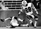 Cleveland Browns player Perry Kemp left misses a pass as New England Patriots player David Hendley right watches during a game at Sullivan Stadium in...