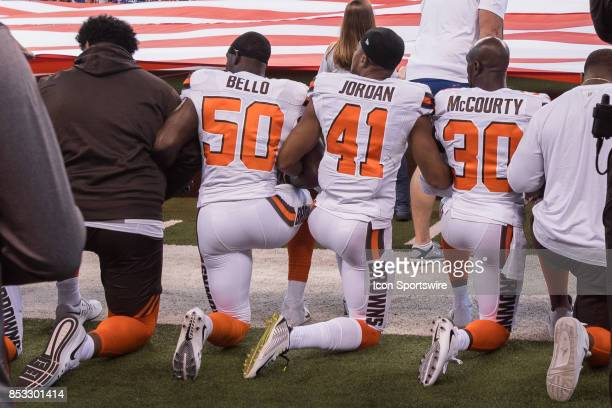 Cleveland Browns players kneel during the national anthem before the NFL game between the Cleveland Browns and Indianapolis Colts on September 24 at...