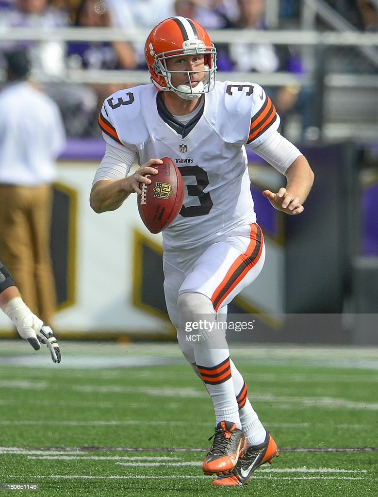 Cleveland Browns quarterback Brandon Weeden looks for a receiver before scrambling out of the pocket against the Baltimore Ravens during the second half of their game on Sunday, September 15, 2013, in Baltimore, Maryland.