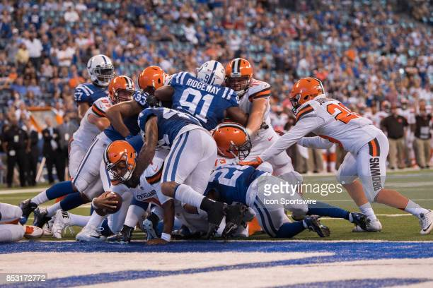 Cleveland Browns quarterback DeShone Kizer dives into the end zone for a late touchdown during the NFL game between the Cleveland Browns and...