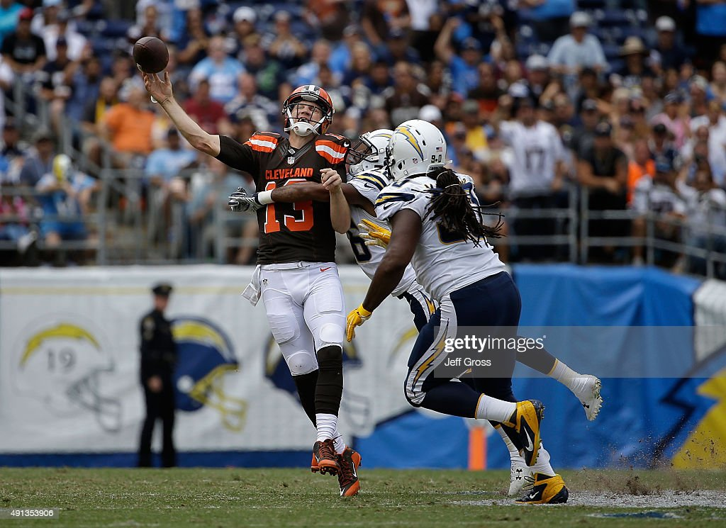 Cleveland Browns quarterback Josh McCown is hit by Patrick Robinson of the San Diego Chargers as Ricardo Mathews of the San Diego Chargers pursues in...