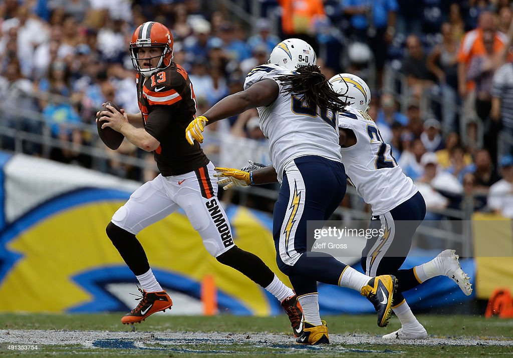 Cleveland Browns quarterback Josh McCown is pressured by Ricardo Mathews and Patrick Robinson of the San Diego Chargers in the first quarter at...