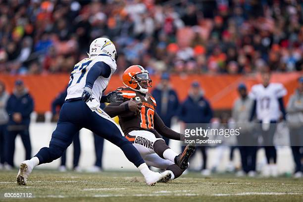 Cleveland Browns Quarterback Robert Griffin III slides down in front of San Diego Chargers Linebacker Jatavis Brown during the first quarter of the...