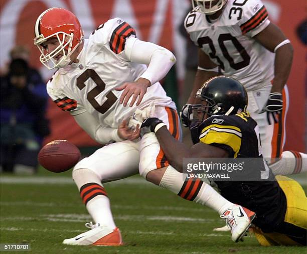 Cleveland Browns' quarterback Tim Couch loses the ball as he is tackled by Pittsburgh Steelers' defender Joey Porter during the fourth quarter on 11...