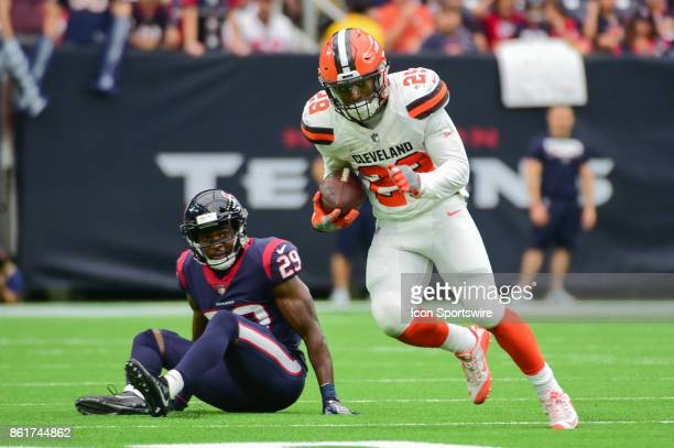 Cleveland Browns running back Duke Johnson Jr looks for running room after breaking a tackle attempt by Houston Texans safety Andre Hal during the...