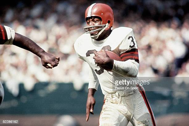 Cleveland Browns' running back Jim Brown runs with the ball Jim Brown played for the Browns from 19571965