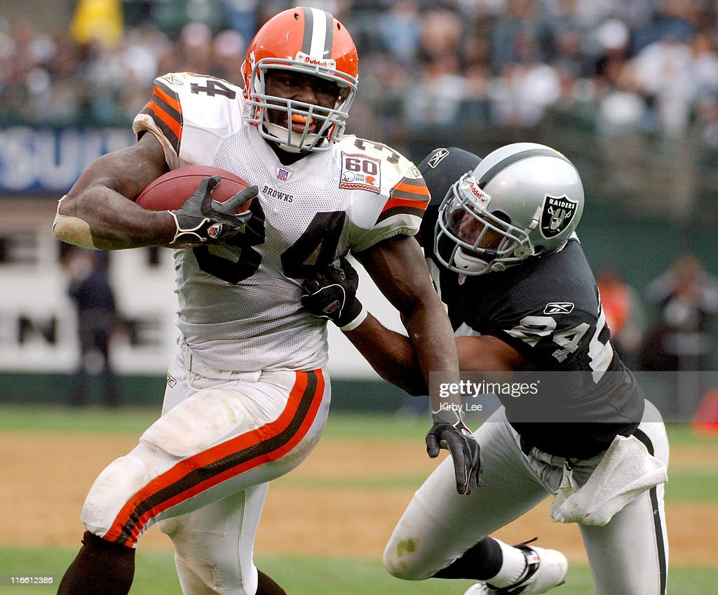 Cleveland Browns running back <a gi-track='captionPersonalityLinkClicked' href=/galleries/search?phrase=Reuben+Droughns&family=editorial&specificpeople=204781 ng-click='$event.stopPropagation()'>Reuben Droughns</a> tries to elude grasp of <a gi-track='captionPersonalityLinkClicked' href=/galleries/search?phrase=Michael+Huff&family=editorial&specificpeople=648298 ng-click='$event.stopPropagation()'>Michael Huff</a> of the Oakland Raiders at McAfee Coliseum in Oakland, Calif. on Sunday, October 1, 2006. The Browns defeated the Raiders, 24-21.