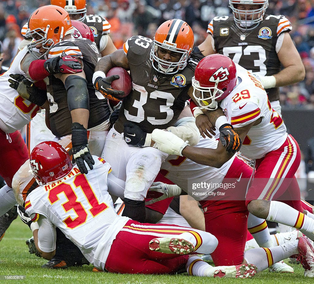 Cleveland Browns running back Trent Richardson (33) plows through the Kansas City Chiefs defensive line in the third quarter as the Cleveland Browns beat the Kansas City Chiefs 30-7, December 9, 2012, in Cleveland, Ohio.