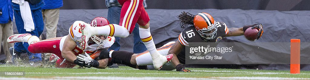 Cleveland Browns wide receiver Josh Cribbs (16) ended up a yard short of the goal line as Kansas City Chiefs linebacker Cory Greenwood (93) stopped him in the third quarter as the Cleveland Browns beat the Kansas City Chiefs 30-7, December 9, 2012, in Cleveland, Ohio.