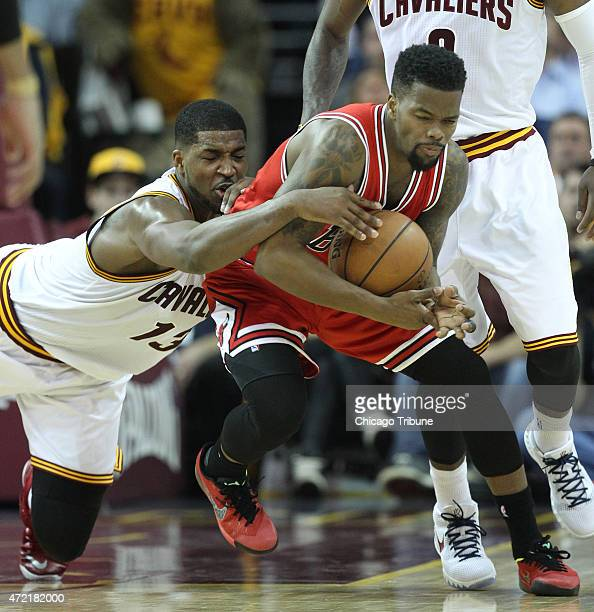 Cleveland Cavaliers center Tristan Thompson dives toward Chicago Bulls guard Aaron Brooks during the fourth quarter of Game 1 of the Eastern...