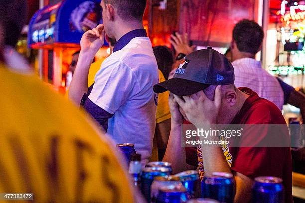 Cleveland Cavaliers fan holds his head while watching Game 6 of the NBA Finals at Paninis Bar and Grill on June 16 2015 in Cleveland Ohio The Golden...