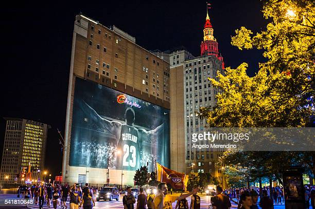 Cleveland Cavaliers fans celebrate in front of a Lebron James mural located on the corner of Huron and Ontario after the Cavaliers defeated the...