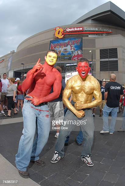 Cleveland Cavaliers fans flex their muscles with their bodies painted red and gold prior to Game Six of the Eastern Conference Finals between the...