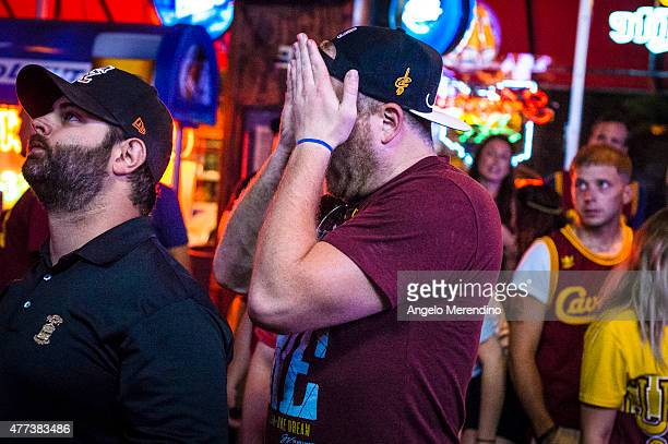 Cleveland Cavaliers fans react while watching Game 6 of the NBA Finals at Paninis Bar and Grill on June 16 2015 in Cleveland Ohio The Golden State...