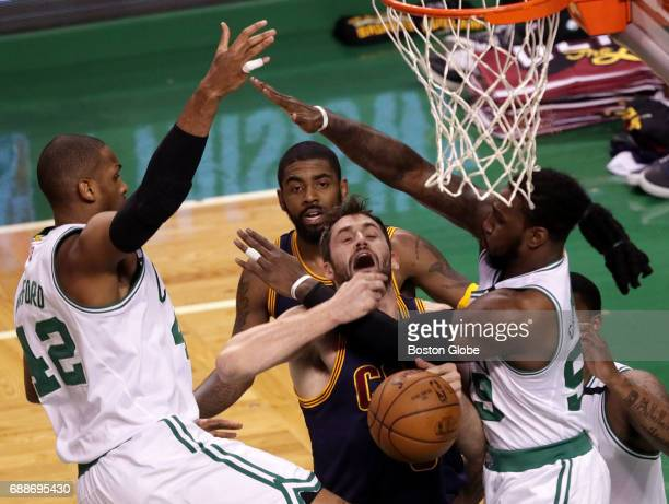 Cleveland Cavaliers forward Kevin Love tries to fight his way through double coverage by Boston Celtics center Al Horford and Boston Celtics forward...