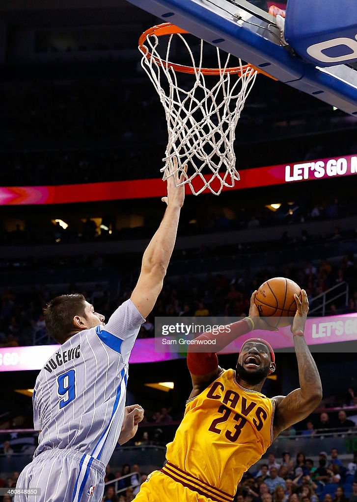 Cleveland Cavaliers forward <a gi-track='captionPersonalityLinkClicked' href=/galleries/search?phrase=LeBron+James&family=editorial&specificpeople=201474 ng-click='$event.stopPropagation()'>LeBron James</a> #23 attempts a shot against Orlando Magic center Nikola Vucevic #9 during the game at Amway Center on December 26, 2014 in Orlando, Florida.