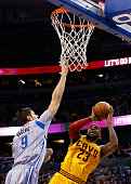 Cleveland Cavaliers forward LeBron James attempts a shot against Orlando Magic center Nikola Vucevic during the game at Amway Center on December 26...