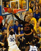 Cleveland Cavaliers forward LeBron James blocks a shot attempt by Golden State Warriors guard Stephen Curry during the second quarter in Game 7 of...