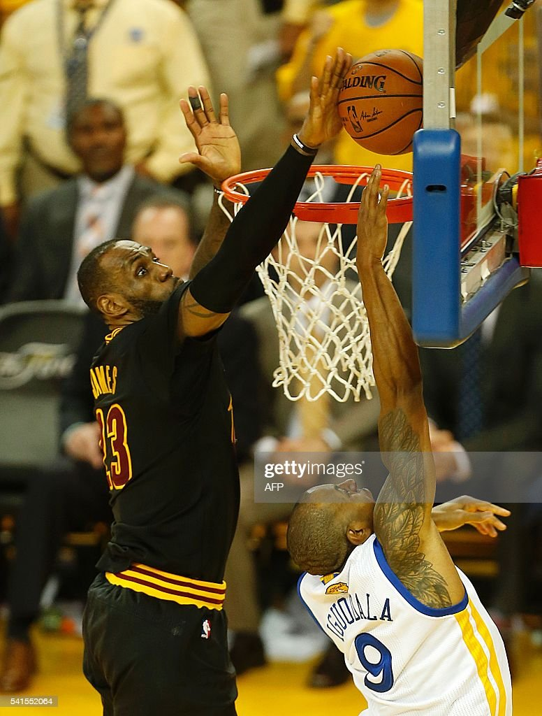 Cleveland Cavaliers forward LeBron James blocks a shot by Golden State Warriors Andre Iguodala during the fourth quarter in Game 7 of the NBA Finals...