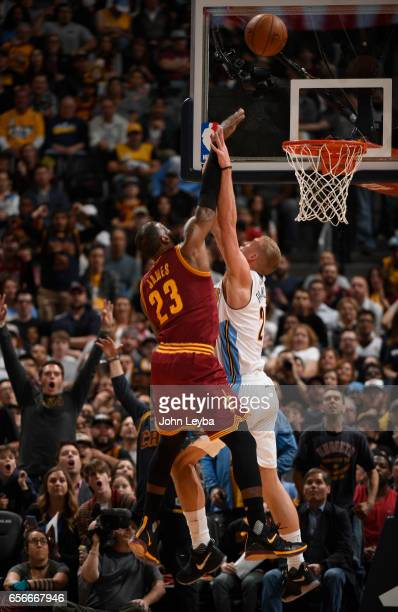 Cleveland Cavaliers forward LeBron James gets fouled by Denver Nuggets center Mason Plumlee during the second quarter on March 22 2017 in Denver...