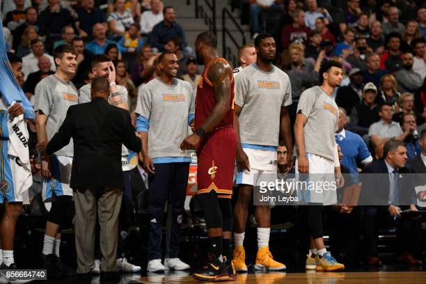 Cleveland Cavaliers forward LeBron James has a few words for the Denver Nuggets bench during the third quarter on March 22 2017 in Denver Colorado at...
