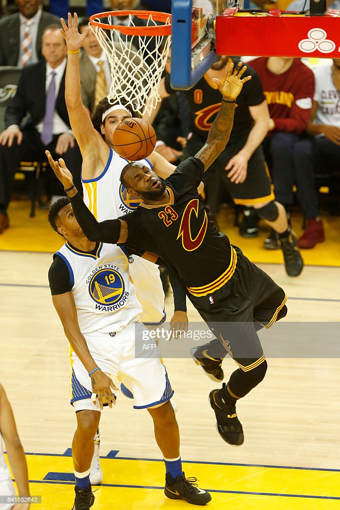 Cleveland Cavaliers forward LeBron James (23) is fouled by Golden State Warriors center Anderson Varejao (back) during the first quarter in Game 7 of the NBA Finals against the Golden State Warriors on June 19, 2016 in Oakland, California. Powered by an amazing effort from LeBron James, the Cleveland Cavaliers completed the greatest comeback in NBA Finals history, dethroning defending champion Golden State 93-89 to capture their first NBA title. The Cavaliers won the best-of-seven series 4-3 to claim the first league crown in their 46-season history and deliver the first major sports champion to Cleveland since the 1964 NFL Browns, ending the longest such title drought for any American city. / AFP / Beck Diefenbach