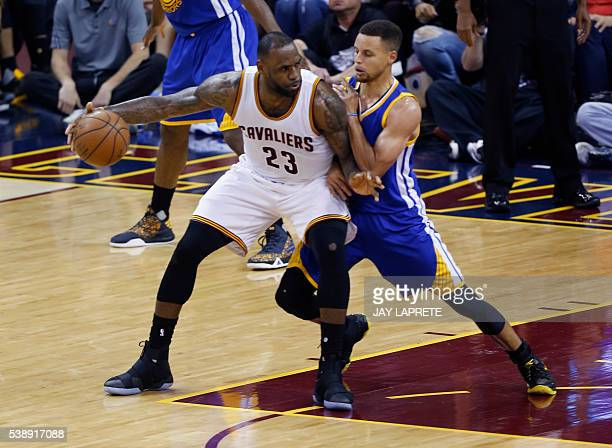 Cleveland Cavaliers forward LeBron James posts up against Golden State Warriors guard Stephen Curry during Game 3 of the NBA Finals in Cleveland Ohio...