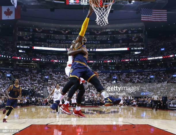 TORONTO MAY 7 Cleveland Cavaliers forward LeBron James scores with Toronto Raptors forward Serge Ibaka on his back as the Toronto Raptors lose the...