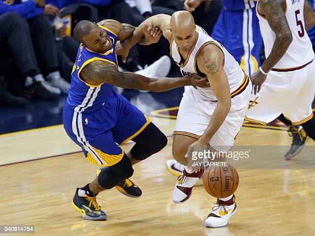 Cleveland Cavaliers forward Richard Jefferson and Golden State Warriors guard Andre Iguodala fight for a loose ball during Game 6 of the NBA Finals...