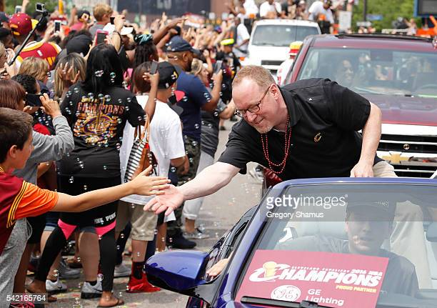 Cleveland Cavaliers General Manager David Griffin waves at fans during the Cleveland Cavaliers Victory Parade And Rally on June 22 2016 in downtown...