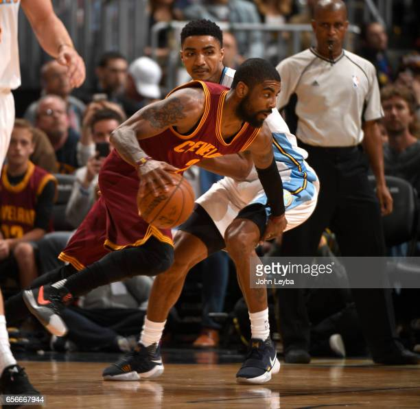Cleveland Cavaliers guard Kyrie Irving drives on Denver Nuggets guard Gary Harris during the second quarter on March 22 2017 in Denver Colorado at...