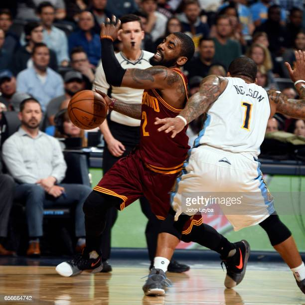 Cleveland Cavaliers guard Kyrie Irving gets fouled by Denver Nuggets guard Jameer Nelson during the third quarter on March 22 2017 in Denver Colorado...